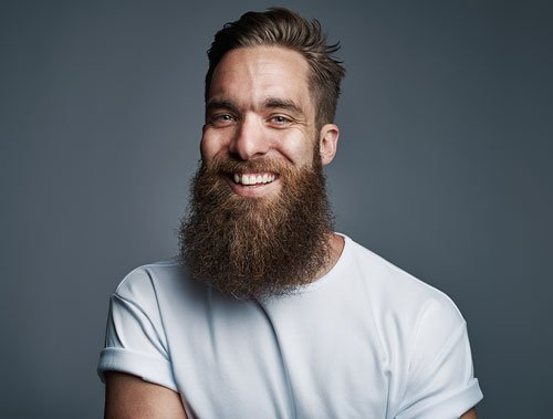 bearded-handsome-man-with-big-smile-P56FMTY