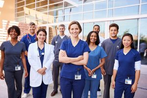 a-team-of-healthcare-workers-with-id-badges-outside