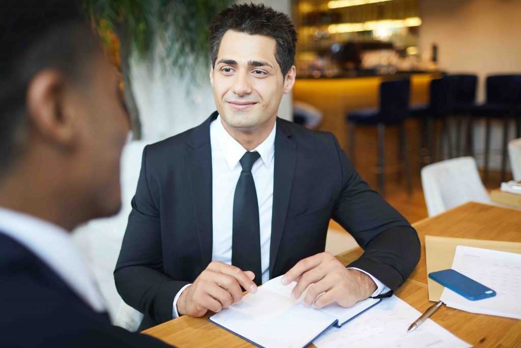 handsome young lawyer meeting with client in restaurant