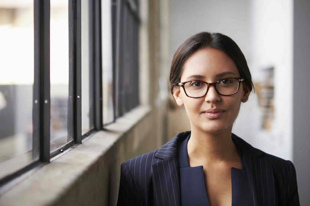 Young mixed race businesswoman wearing glasses, portrait